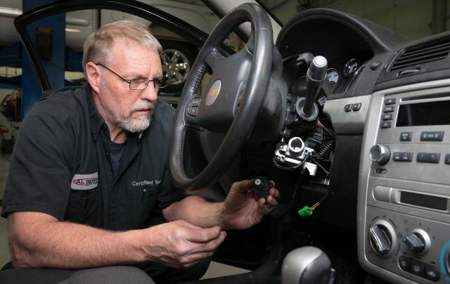 Gary Pittam performs recall service on a Chevrolet Cobalt Thursday, April 17, 2014, at Al Serra Chevrolet in Grand Blanc, Michigan. (Photo by John F. Martin for General Motors)