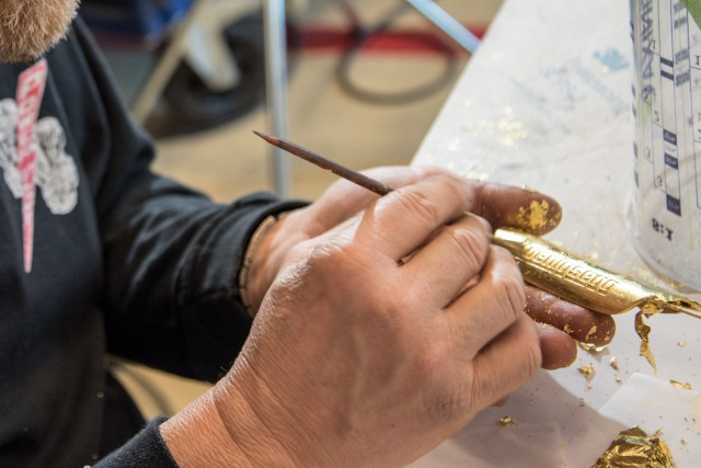 Gold leaf application process at Koenigsegg factory in Ängelholm, Sweden