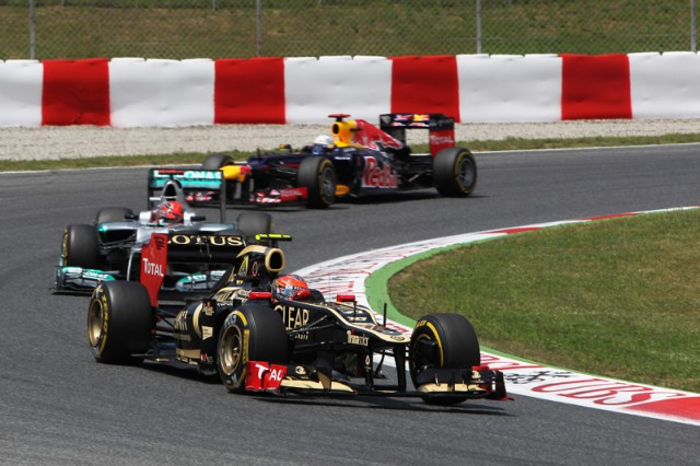 Grosjean leads a train - Lotus F1 Team photo