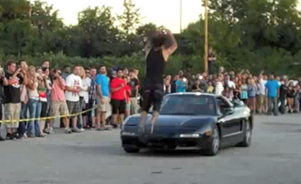 Man completes jump over moving Acura NSX