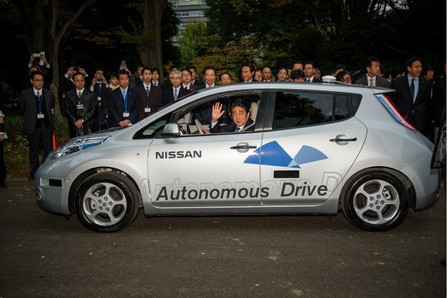 Japanese Prime Minister Shinzo Abe rides in an Autonomous Drive Nissan Leaf (November 9, 2013)