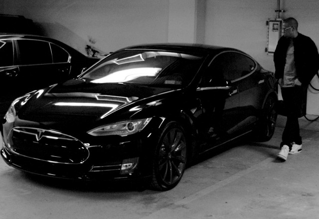 JayZ with Tesla Model S electric car, from Beyonce's website, April 2014
