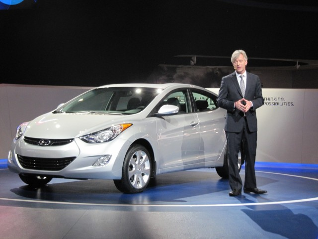 John Krafcik, CEO of Hyundai America, with 2012 Hyundai Elantra sedan at Chicago Auto Show, Feb 2012