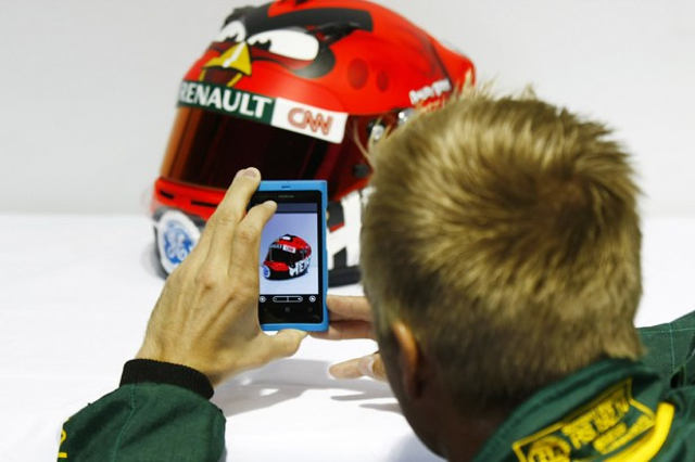 Kovalainen inspects his new lid. Image: Caterham F1