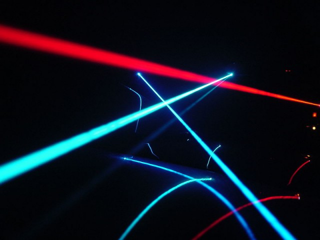 Laser beams on a car windshield, photo courtesy of Wikimedia Commons