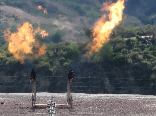 Natural gas flaring from oil well [licensed under Creative Commons from Flickr user Sirdle]