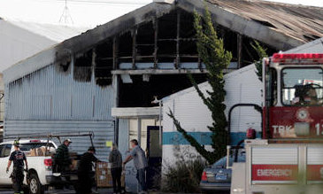 Neil Young's burned warehouse -- image via Mercury News/Anda Chu