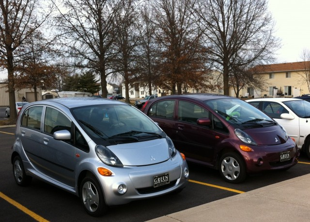 Pair of Mitsubishi i-MiEV electric cars parked at work [photo: Jen Danziger]