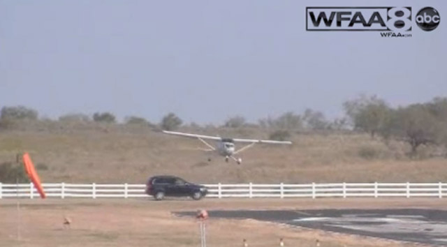 Photo of a light plane about to crash into a moving vehicle while attempting to land