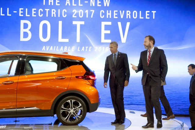 President Barack Obama looks at 2017 Chevrolet Bolt EV electric car at Detroit Auto Show, Jan 2016