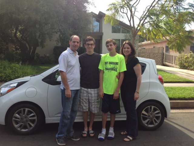 Rick, Alex, David & Christine Prell with new 2014 Chevrolet Spark EV, Studio City, CA