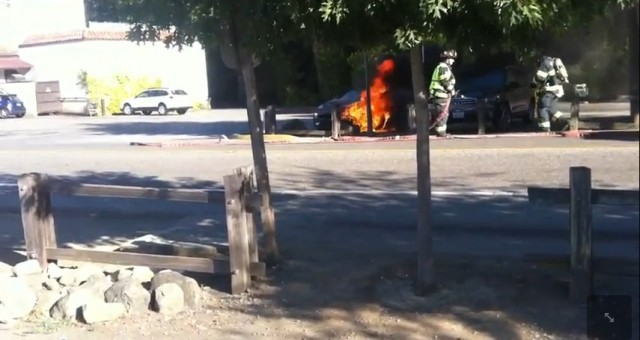 Screen capture from video by Aaron Wood of fire in 2012 Fisker Karma in Wooside, CA, August 2012