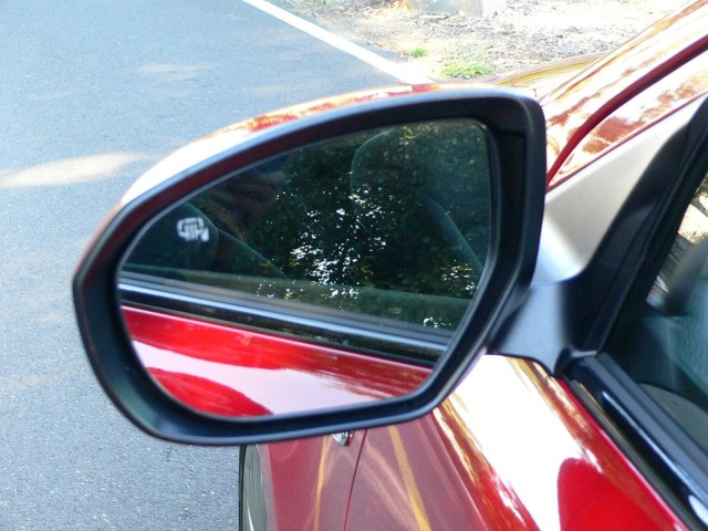 Large, sculpted mirrors were useful for visibility but a bit noisy in our pre-production test car.