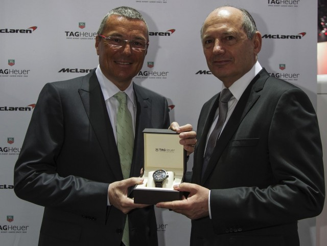 TAG Heuer's Jean-Christophe Babin poses with McLaren's Ron Dennis