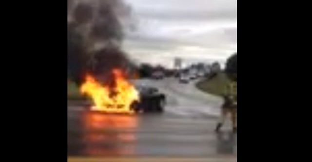 Tesla Model S in flames near Kent, Washington [frame from YouTube video]