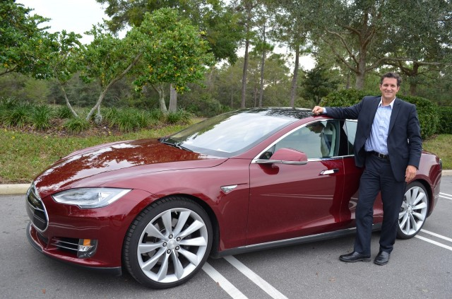 Tesla Model S owner David Metcalf after covering more than 400 miles [photo: Gene Kruckemyer]