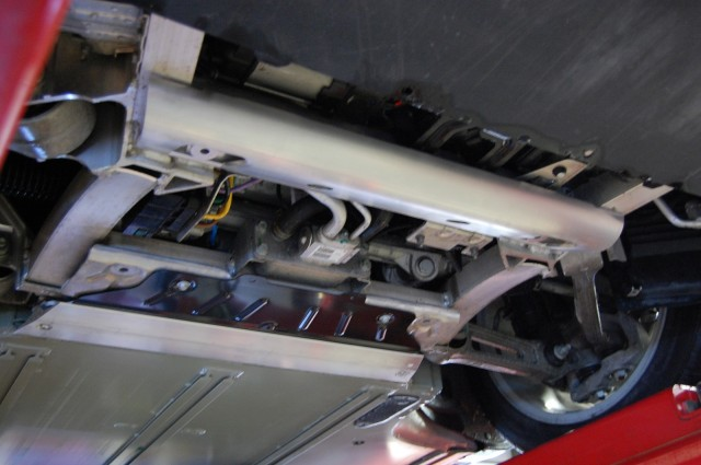 Tesla Model S added battery shield - half-tube, black titanium plate, T-section, from front to rear