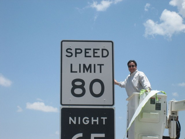 Texas legislator Pete Gallego (D-Alpine) unveils an 80 mph speed limit sign