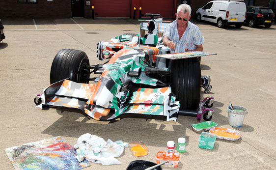The former Force India F1 car, repainted by Dexter Brown. Image: RM Auctions