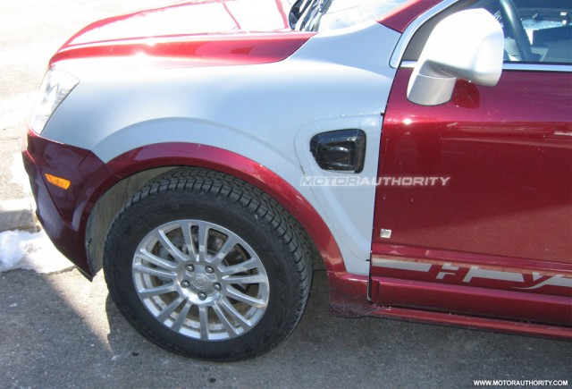 Theta-based plug-in hybrid crossover prototype spy shots