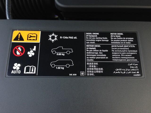 Underhood safety warning label referring to diesel engine found on 2015 Chevrolet Tahoe