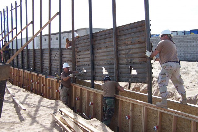 US Air Force airmen install a fence along the US-Mexico border east of San Luis, AZ