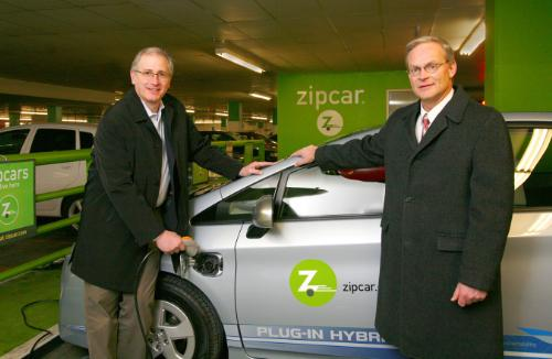 Zipcar's Scott Griffith and Toyota's Frank Miller with a Toyota Prius PHV