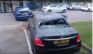 Frame from video showing Tesla Model S after it hit Mercedes dealership  [source: RatDog on YouTube]