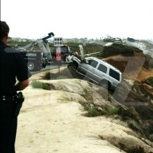Junior Seau's Cadillac Escalade being hauled back up the cliff -- via TMZ