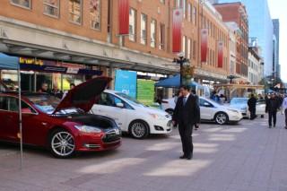 National Drive Electric Week 2014: Eyeing a Tesla in Ottawa. Photo by Ottawa Centre EcoDistrict.