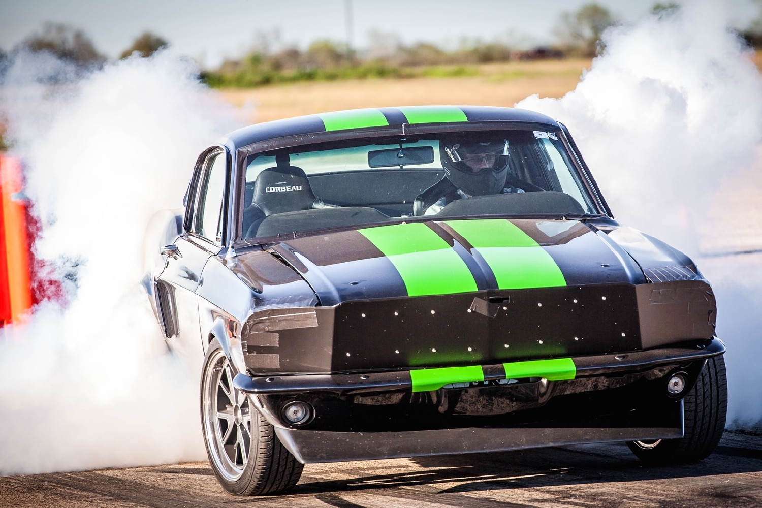 Ford mustang electric drag car does 0 to 60 mph under 2 seconds targets 200 mph
