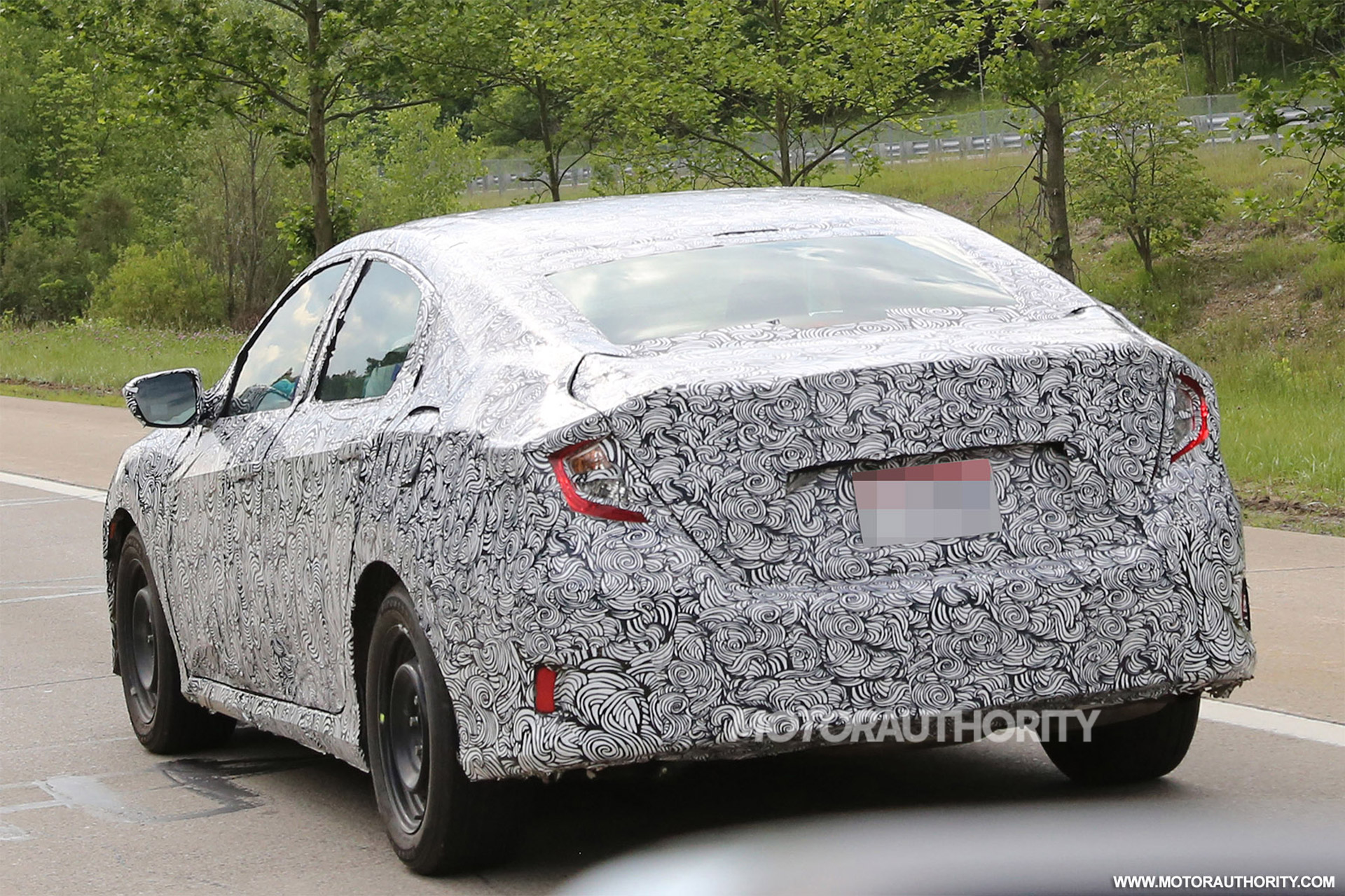 en first motor honda civic profile test news touring trend side review