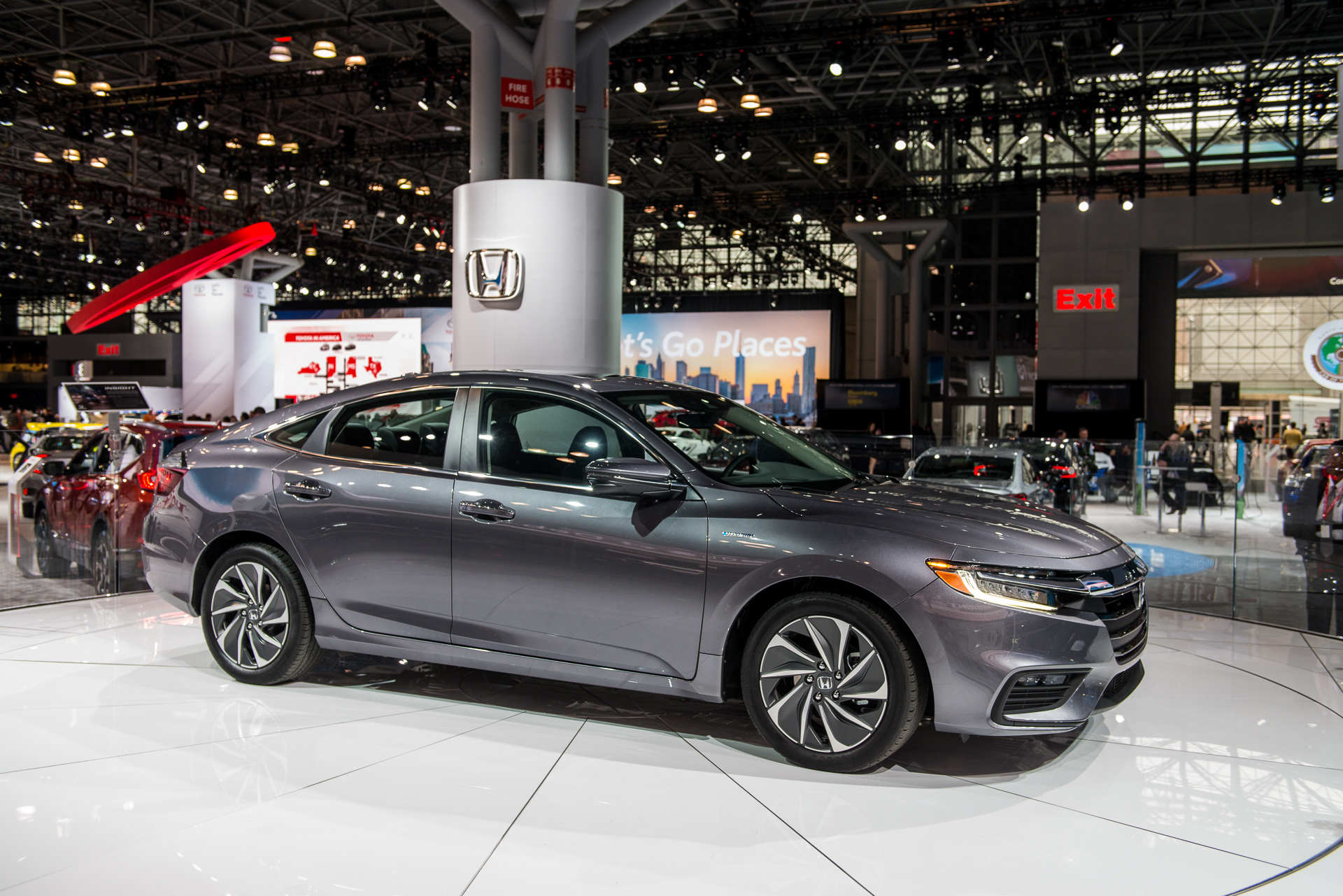 Honda Insight production, electric car advertising, and ...