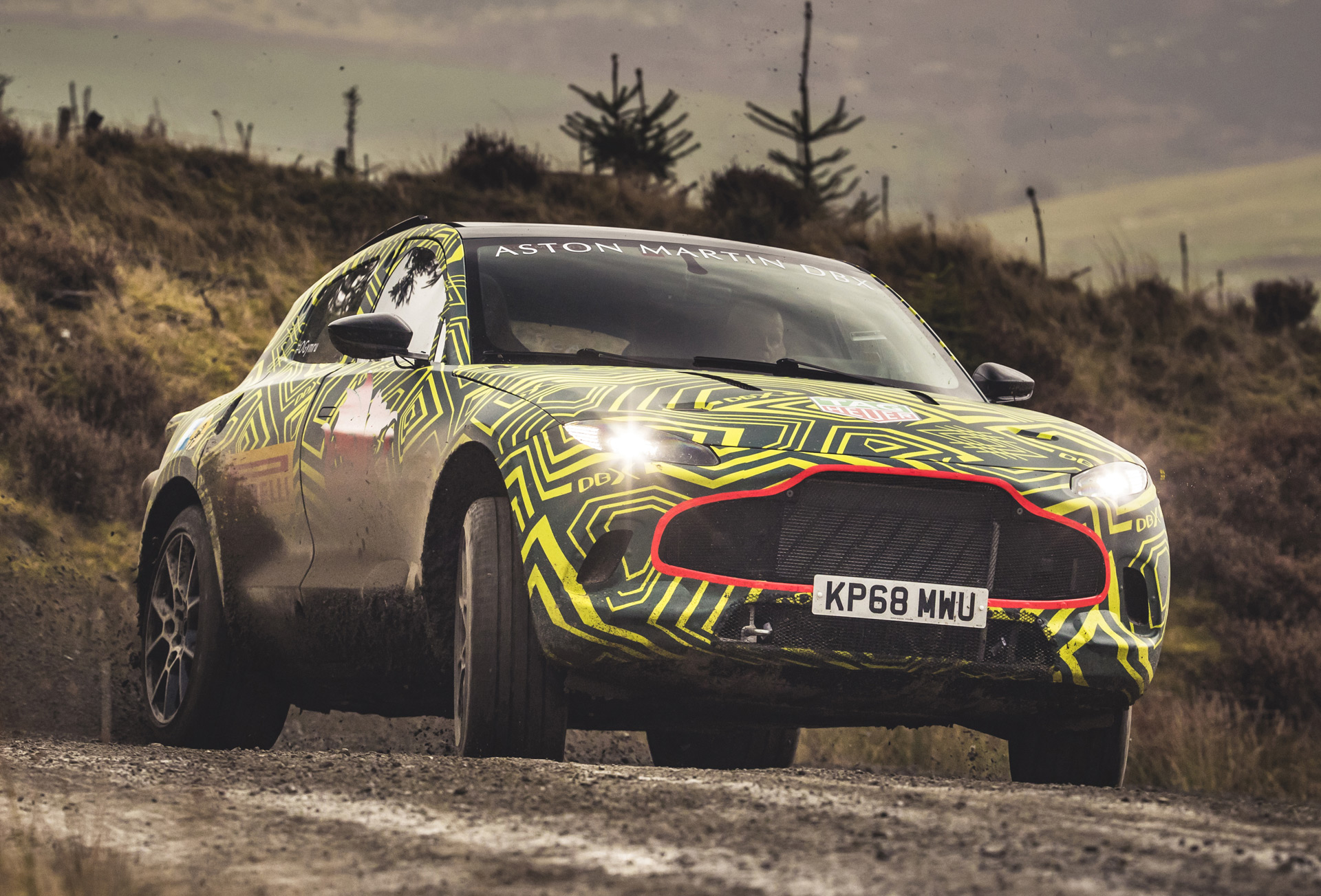 aston martin reveals dbx name, first prototype for suv