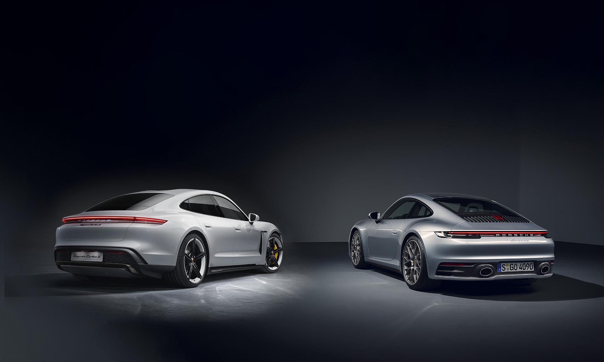 2020 Porsche 911 vs. 2020 Porsche Taycan Performance past