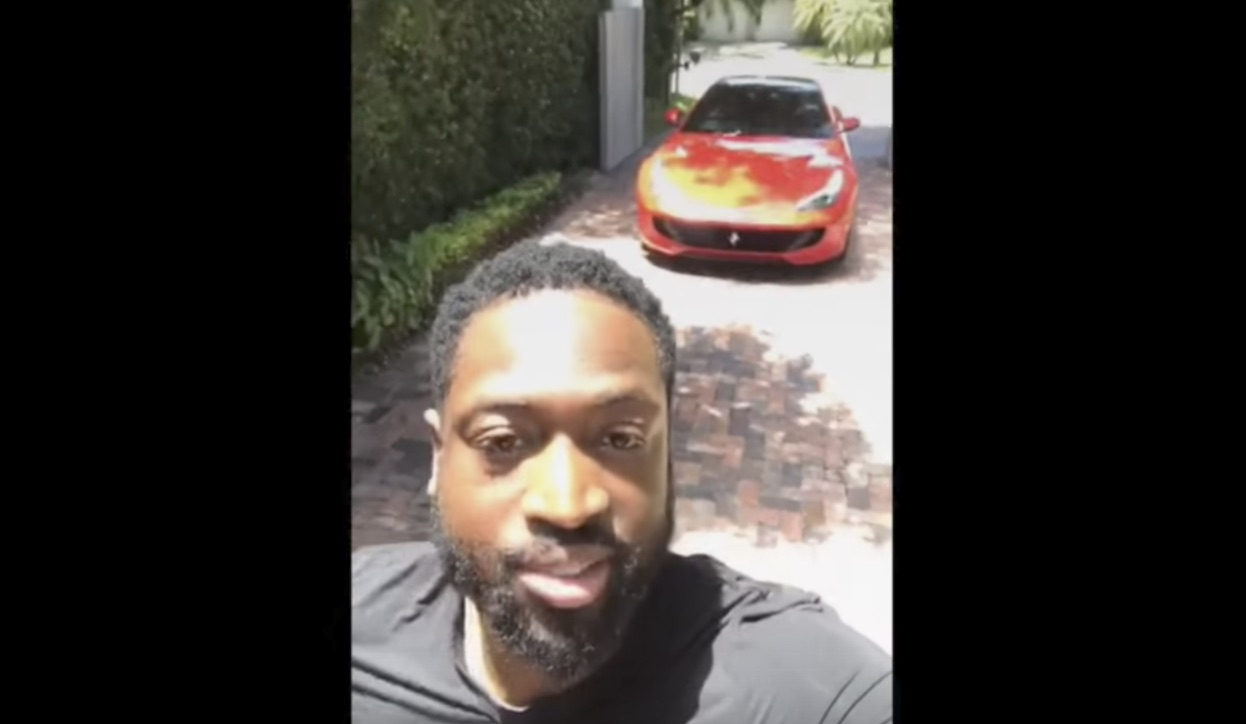 Watch Dwyane Wade let his 15-year-old son drive his Ferrari