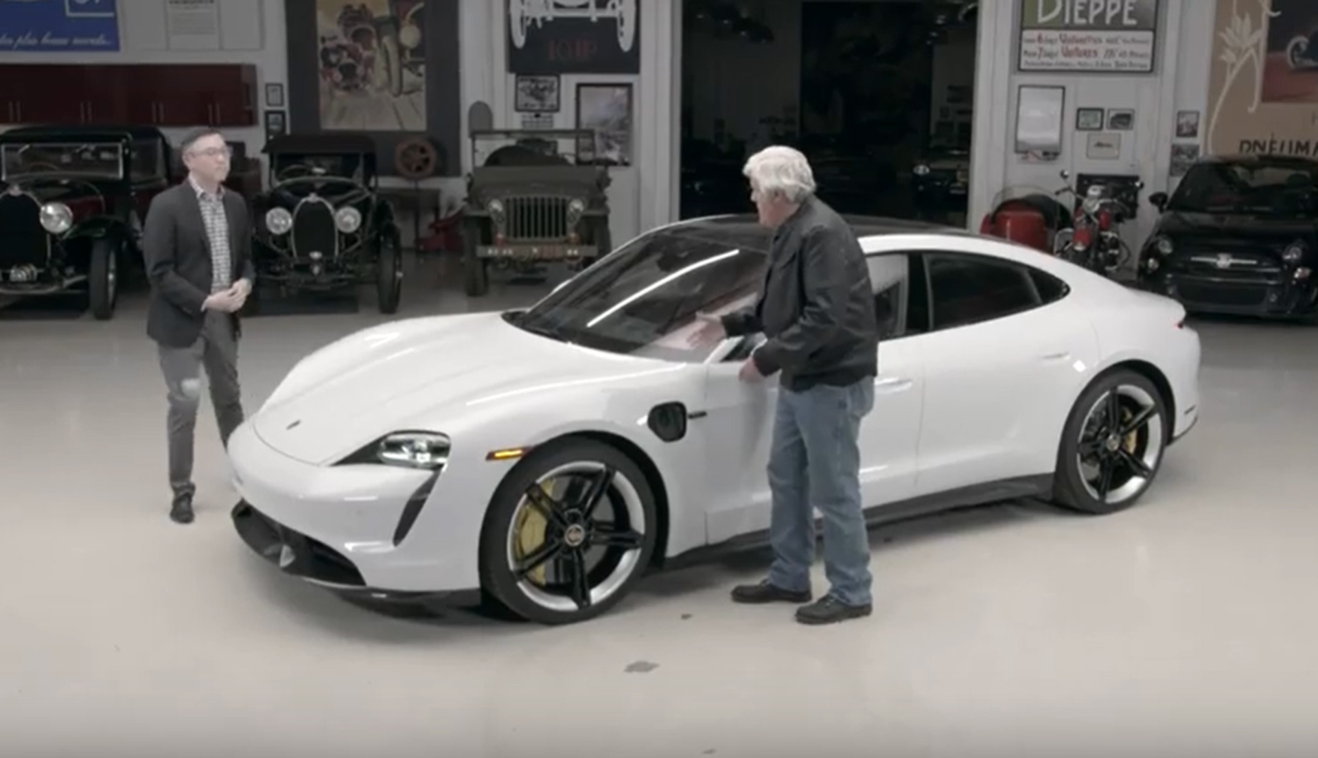 Jay Leno has his first dab at driving the Porsche Taycan