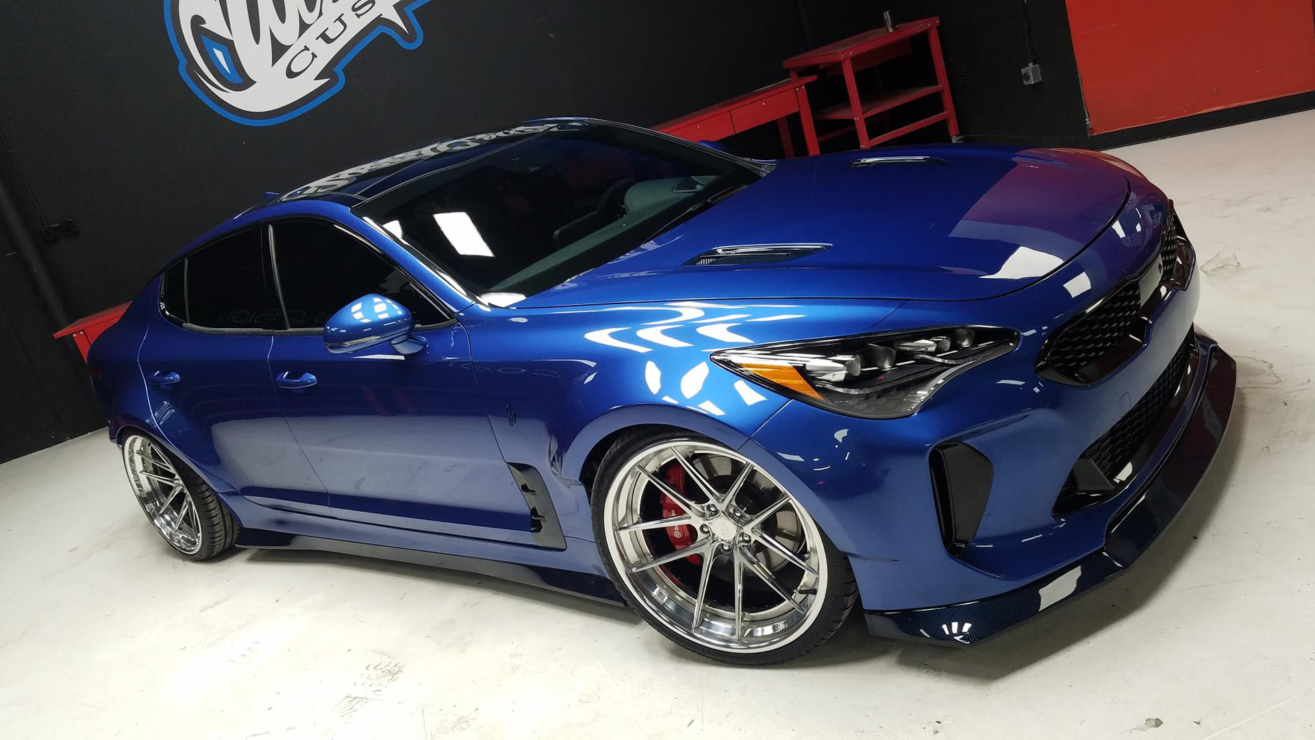 Prepare to drool wide body kia stinger debuts at sema for West coast electric motors