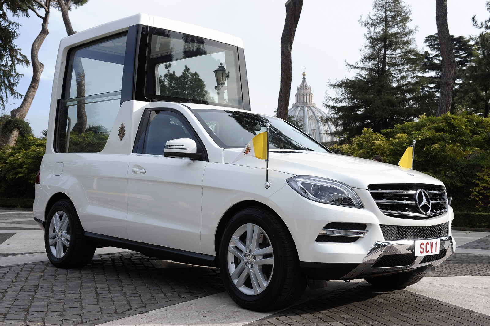 pope francis presented with mercedes m class-based popemobile