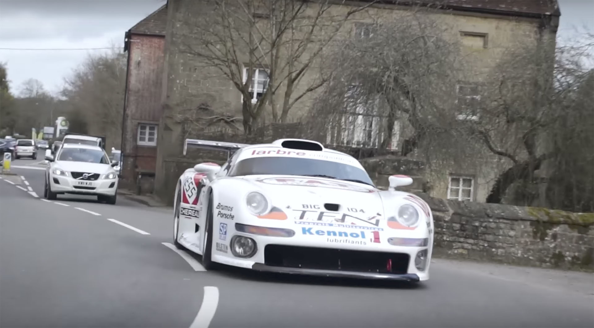 Take a ride in the Porsche 911 GT1 down a public street