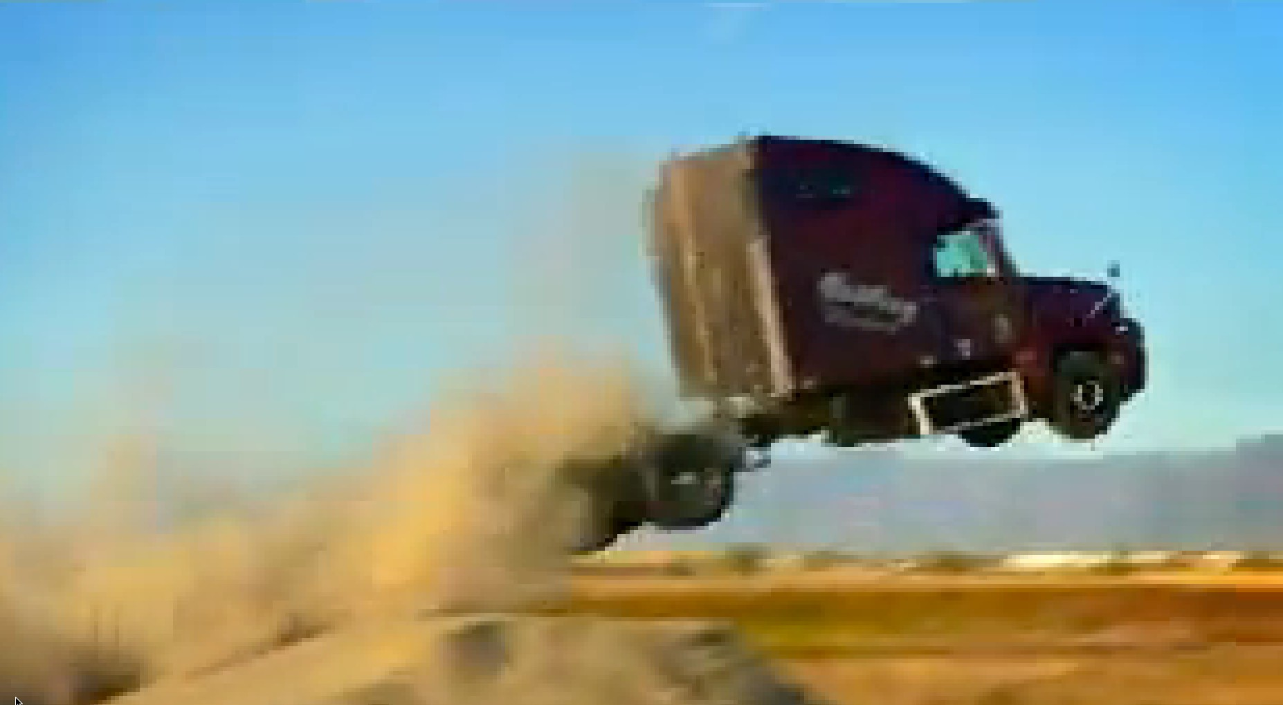 Semi-Truck Driver Goes For Jump Record, Winds Up At A Yard Sale: Video