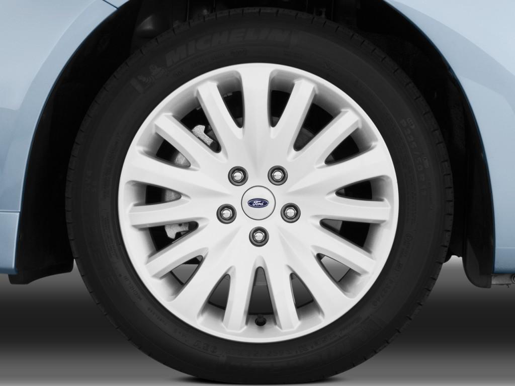 image 2010 ford fusion hybrid 4 door sedan hybrid fwd wheel cap size 1024 x 768 type gif. Black Bedroom Furniture Sets. Home Design Ideas