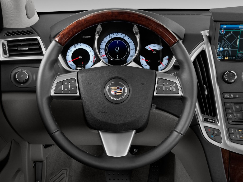 interior drive features cadillac price photos base reviews suv front srx wheel seats