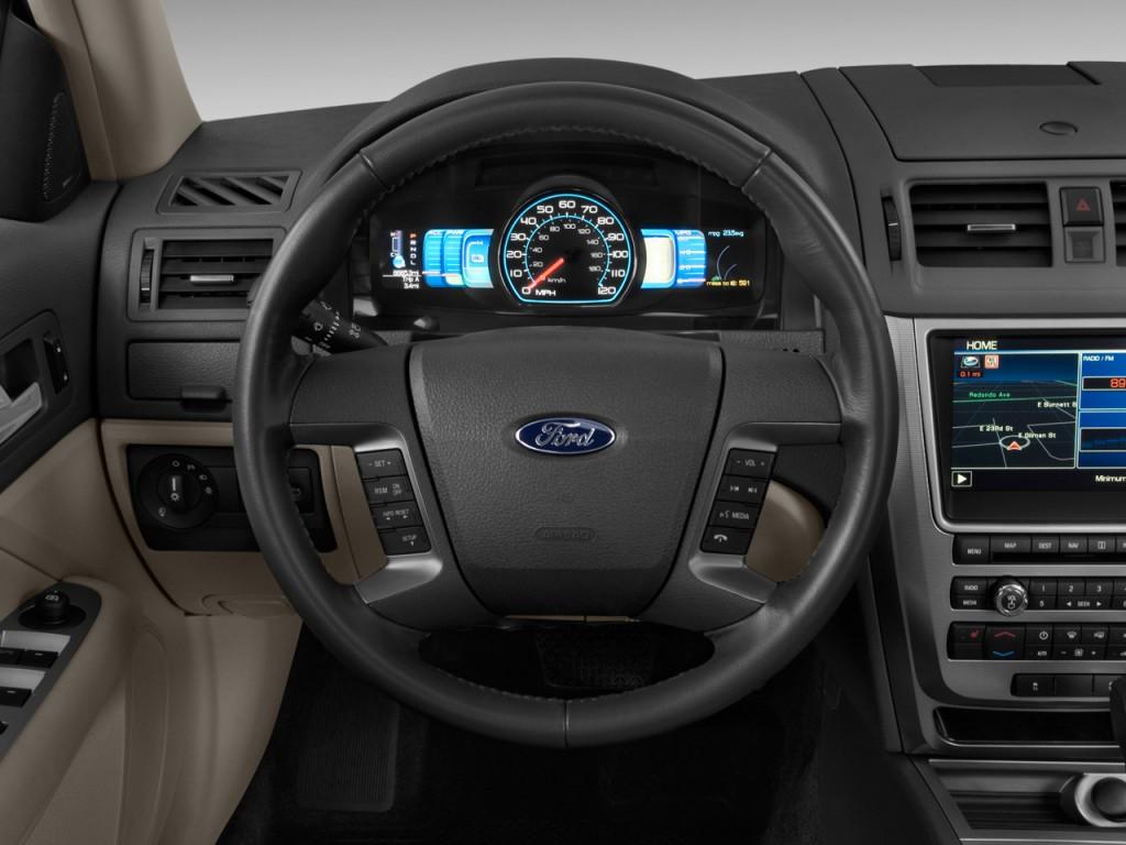 image 2012 ford fusion 4 door sedan hybrid fwd steering wheel size 1024 x 768 type gif. Black Bedroom Furniture Sets. Home Design Ideas