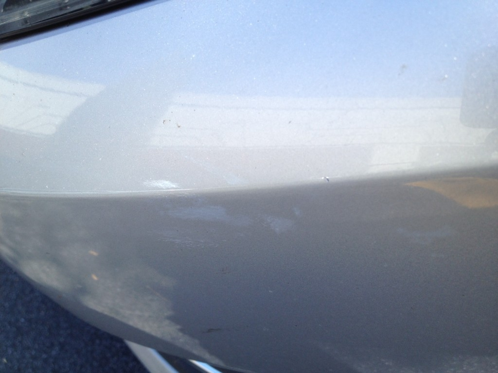 2012 Volkswagen Passat TDI Six-Month Road Test fender rub