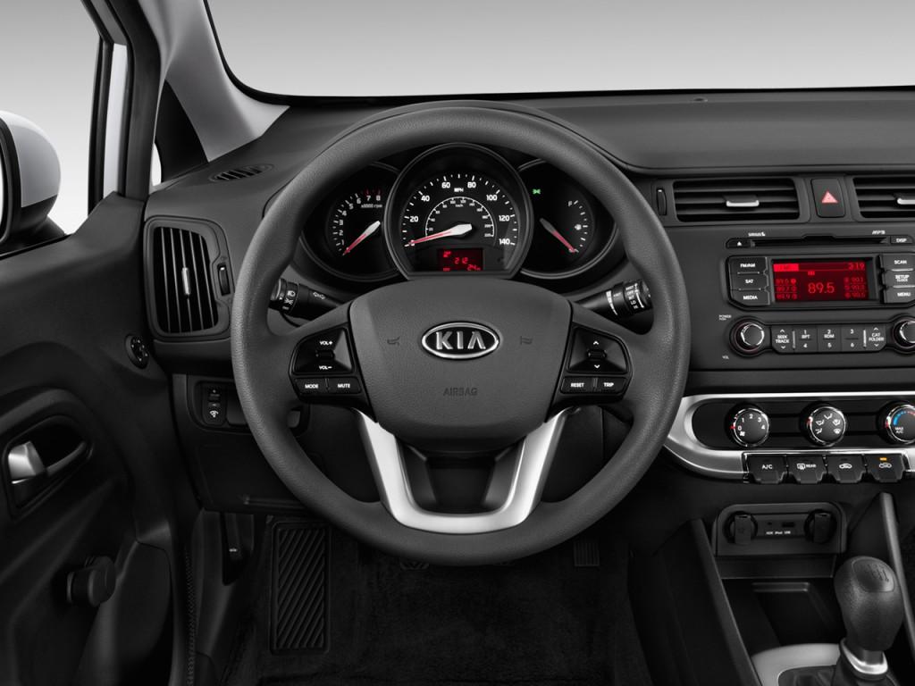 image 2013 kia rio 4 door sedan auto lx steering wheel. Black Bedroom Furniture Sets. Home Design Ideas