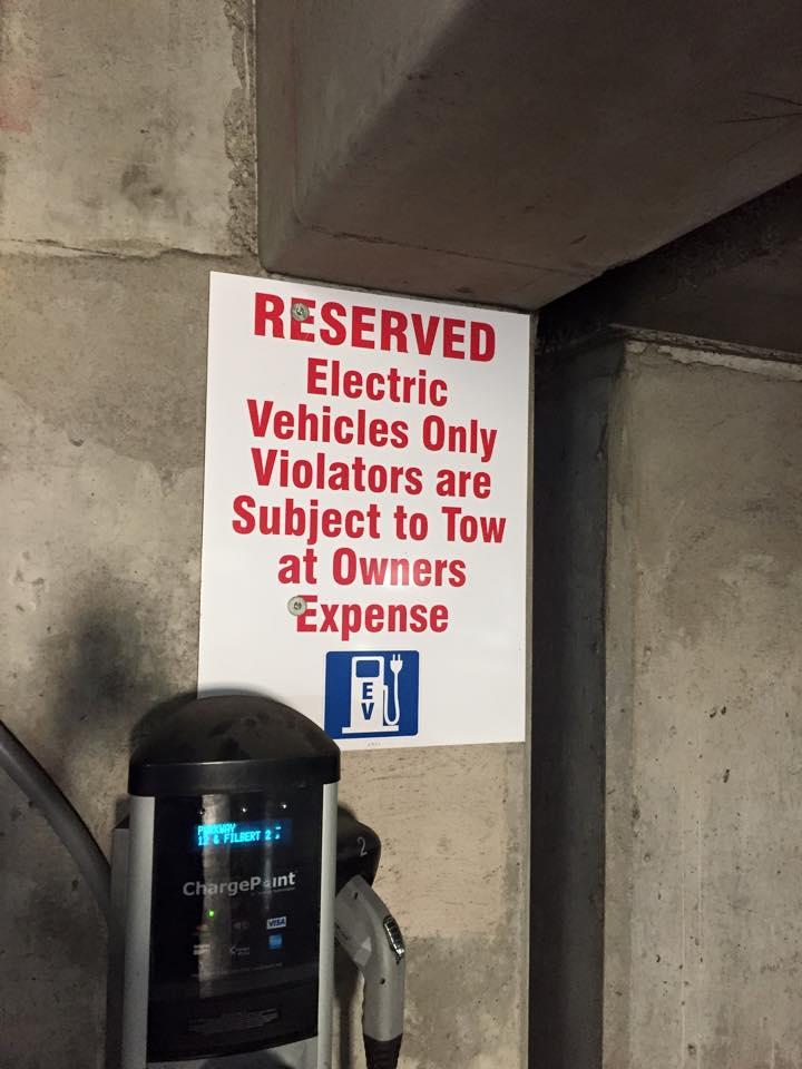 Electric Vehicle Only parking sign, Philadelphia public garage   [photo: Jim Burness]