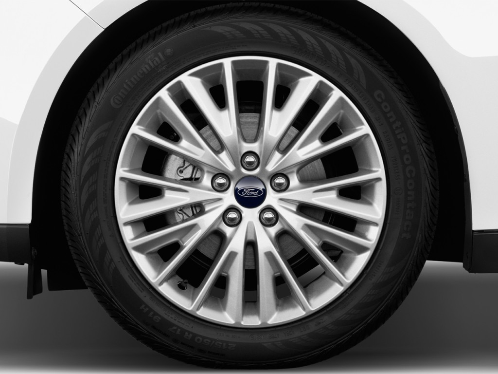 Used Ford Taurus >> Image: 2016 Ford Focus 4-door Sedan Titanium Wheel Cap ...