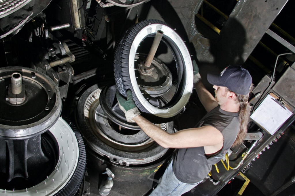 A tire is inspected as it emerges from the mold