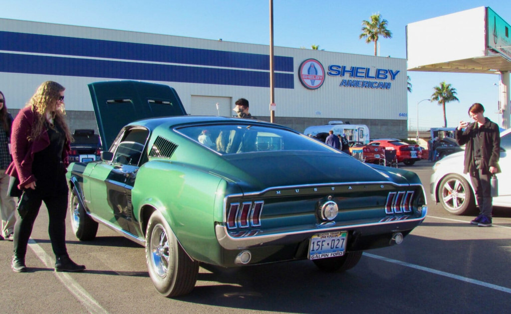 A vintage Mustang in Bullitt-green color draws attention at the Cars and Coffee Las Vegas event in t